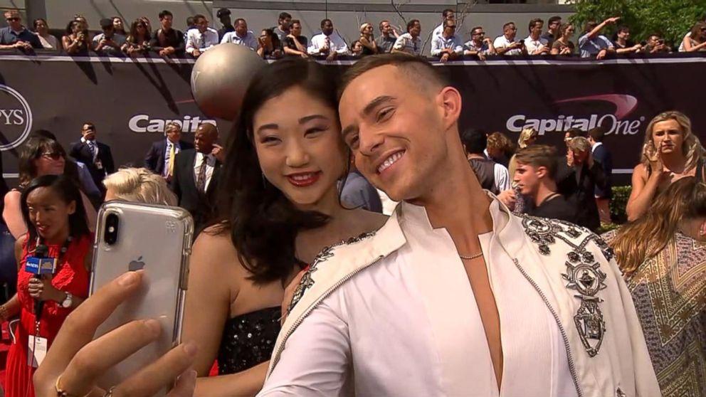 Adam Rippon and Mirai Nagasu snap a selfie together on the 2018 ESPY Awards red carpet.