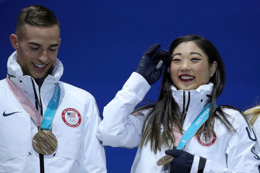 PHOTO: Bronze medalists Adam Rippon and Mirai Nagasu of team U.S. celebrate during the victory ceremony after the figure skating team event at Medal Plaza, Feb. 12, 2018, in Pyeongchang, South Korea.