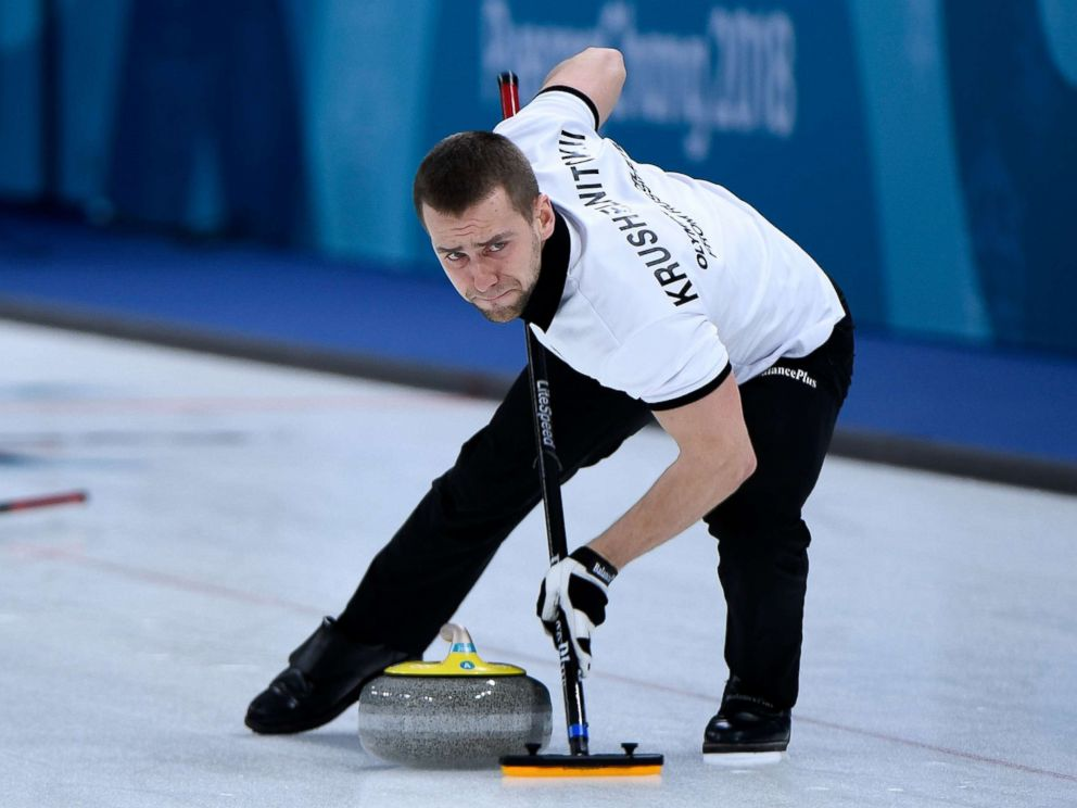 PHOTO: Russias Aleksandr Krushelnitckii brushes the ice surface during the curling mixed doubles round robin session between the U.S. and the Olympic Athletes from Russia during the Pyeongchang 2018 Winter Olympics, Feb. 8, 2018.