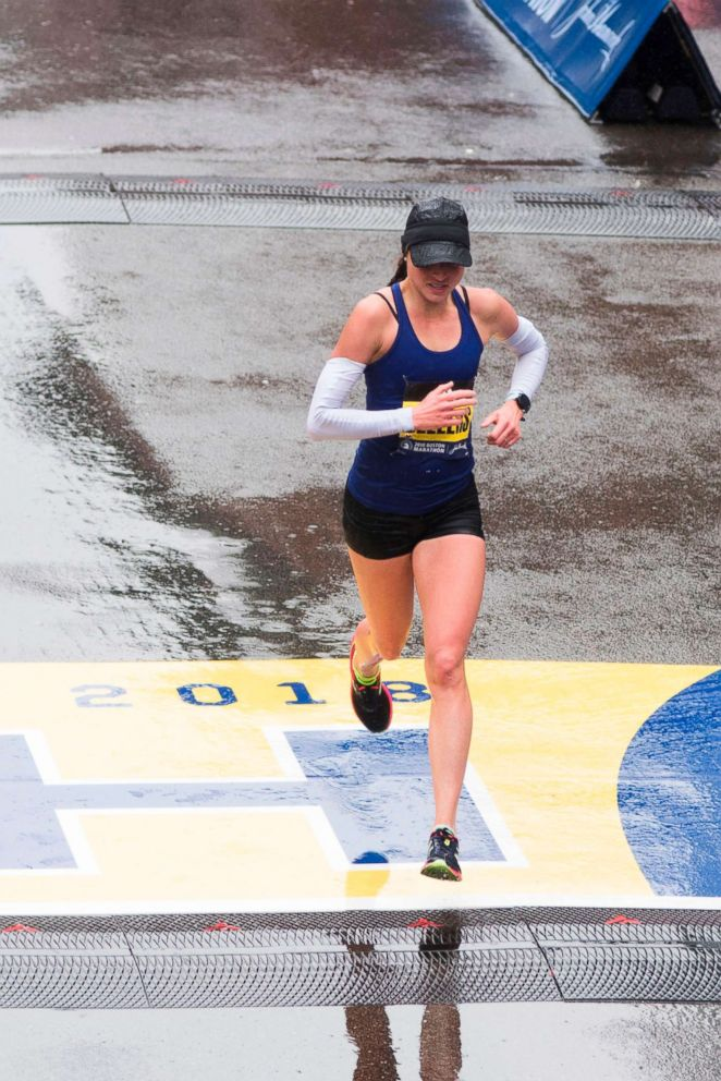 PHOTO: Sarah Sellers crosses the finish line in second place for the 122nd Boston Marathon, April 16, 2018, in Boston.