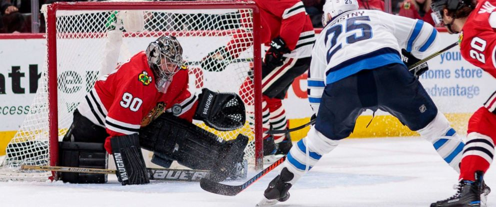 PHOTO: Chicago Blackhawks emergency-goaltender Scott Foster stops a shot by Paul Stastny of the Winnipeg Jets during a National Hockey League game at the United Center in Chicago, March 29, 2018.