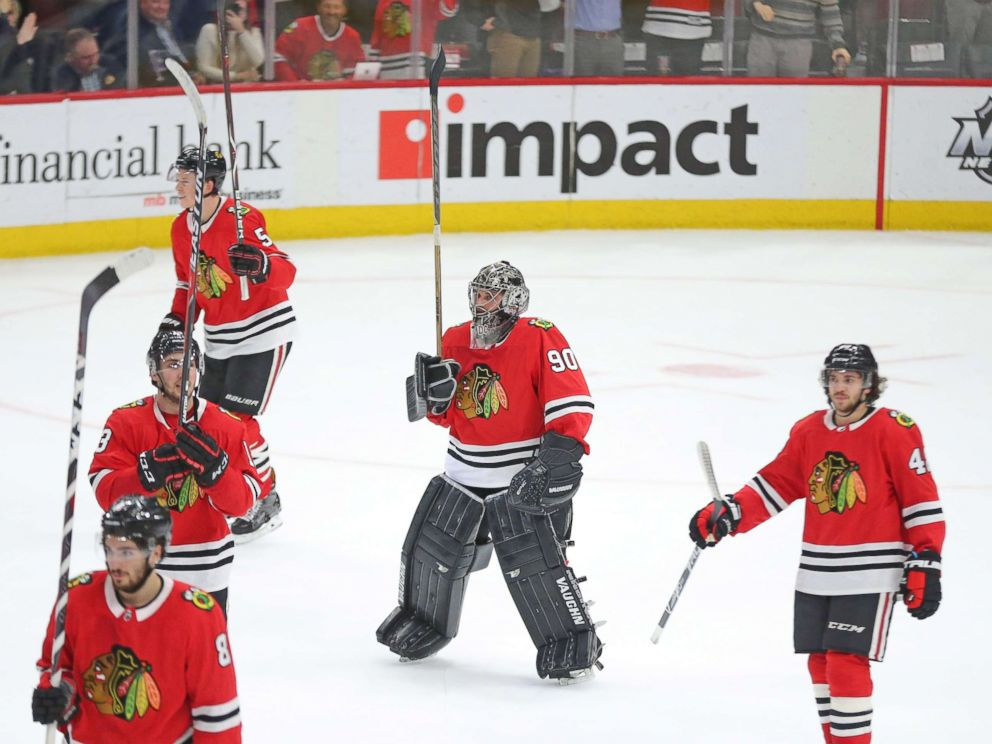 PHOTO: Chicago Blackhawks emergency goalie Scott Foster, center, celebrates following the third period against the Winnipeg Jets at the United Center in Chicago, March 29, 2018.