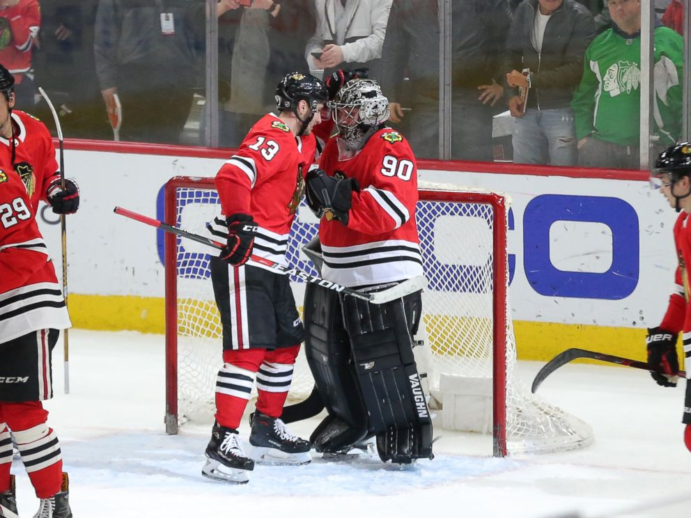 PHOTO: Chicago Blackhawks emergency goalie Scott Foster is congratulated by Tomas Jurco following the third period against the Winnipeg Jets at the United Center in Chicago, March 29, 2018.