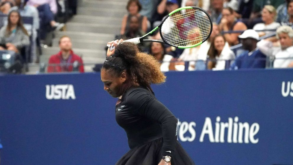 Serena Williams smashes her racket while playing against Naomi Osaka of Japan during their Women's Singles Finals match at the 2018 US Open in New York, Sept. 8, 2018.