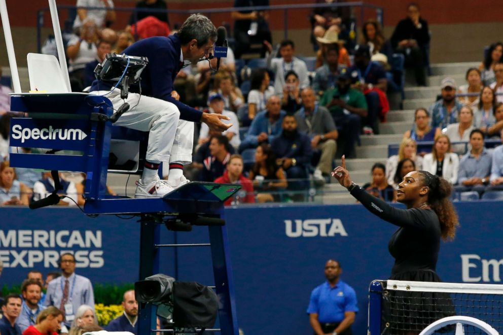 PHOTO: Serena Williams of the US argues with chair umpire Carlos Ramos while playing Naomi Osaka of Japan during their 2018 US Open womens singles final match on Sept. 8, 2018 in New York.