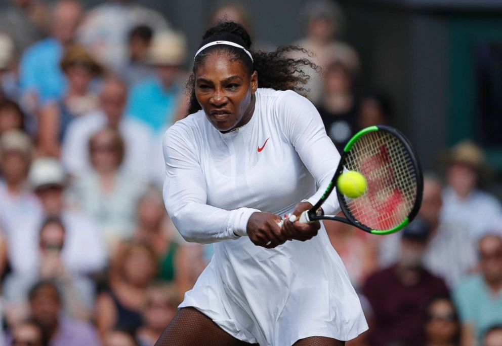 PHOTO: Serena Williams of the U.S. returns a ball to Angelique Kerber of Germany during the womens singles final match at the Wimbledon Tennis Championships, in London, July 14, 2018.