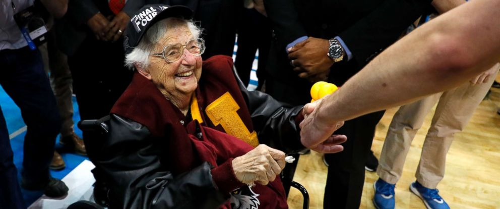 PHOTO: Sister Jean Dolores Schmidt celebrates with the Loyola Ramblers after defeating the Kansas State Wildcats during the 2018 NCAA Mens Basketball Tournament South Regional at Philips Arena, March 24, 2018, in Atlanta.