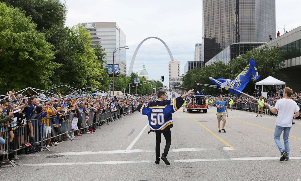 PHOTO: St. Louis Blues goaltender Jordan Binnington celebrates with fans during the NHL hockey Stanley Cup victory celebration in St. Louis.
