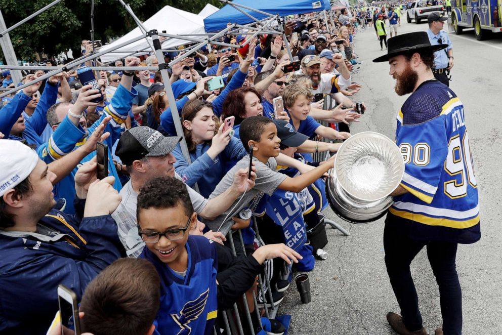 PHOTO: St. Louis Blues center Ryan OReilly carries the Stanley Cup during the celebration.