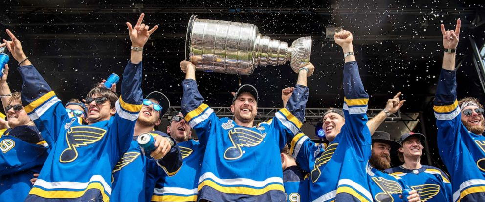 PHOTO:Alex Pietrangelo of the St. Louis Blues hoists the Stanley Cup while celebrating with his teammates during the St Louis Blues Victory Parade and Rally after winning the 2019 Stanley Cup Final on June 15, 2019, in St Louis.