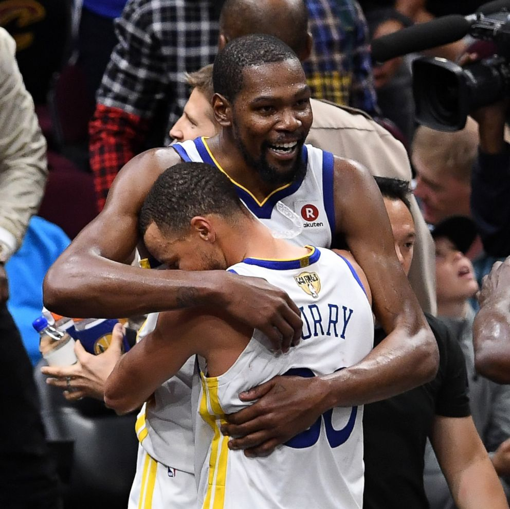 PHOTO: Stephen Curry #30 and Kevin Durant #35 of the Golden State Warriors celebrate late in the game against the Cleveland Cavaliers during the 2018 NBA Finals at Quicken Loans Arena on June 8, 2018 in Cleveland, Ohio.