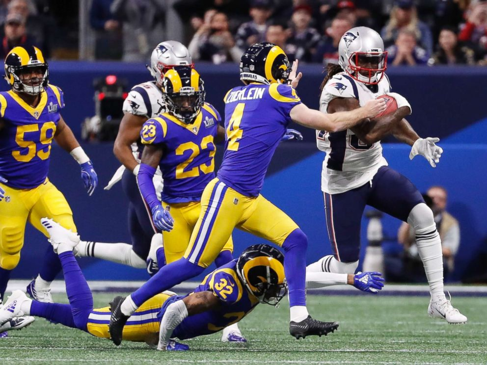 PHOTO: New England Patriots Cordarrelle Patterson in action with Los Angeles Rams Greg Zuerlein, Feb. 3, 2019.