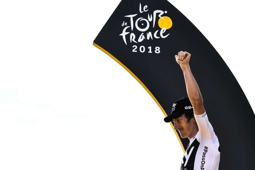 PHOTO: Tour de France winner Great Britains Geraint Thomas celebrates on the podium after the 21st and last stage of the 105th edition of the Tour de France cycling race in Paris, July 29, 2018.