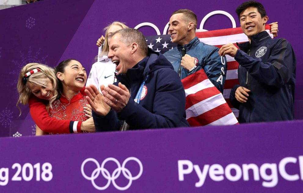 PHOTO: Mirai Nagasu, is surrounded by fellow U.S. skating team members, as she reacts to her score in the Figure Skating Team Event Ladies Single Free Skating, Feb. 12, 2018.