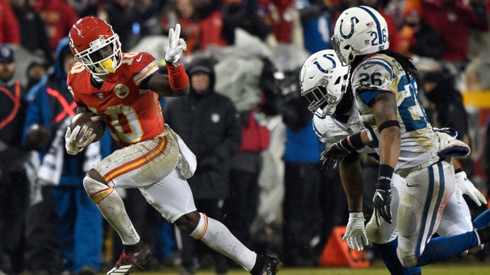 In this Jan. 12, 2019, file photo, Kansas City Chiefs wide receiver Tyreek Hill (10) gestures as he runs past Indianapolis Colts safety Clayton Geathers (26) and linebacker Anthony Walker during the second half of an NFL divisional football playoff game in Kansas City, Mo.