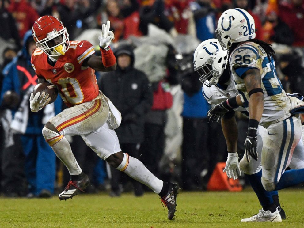 PHOTO: In this Jan. 12, 2019, file photo, Chiefs wide receiver Tyreek Hill gestures as he runs past Colts safety Clayton Geathers and linebacker Anthony Walker during the second half of an NFL divisional football playoff game in Kansas City, Mo.