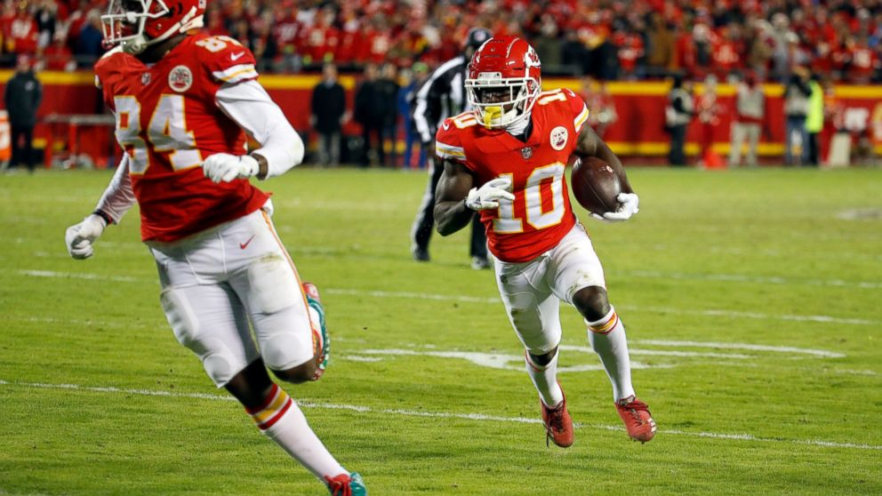 Kansas City Chiefs wide receiver Tyreek Hill (10) runs for a touchdown behind tight end Demetrius Harris (84) during the second half of an NFL football game against the Oakland Raiders in Kansas City, Mo., Sunday, Dec. 30, 2018.