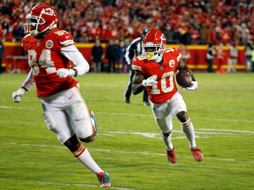 PHOTO: Kansas City Chiefs wide receiver Tyreek Hill (10) runs for a touchdown behind tight end Demetrius Harris (84) during the second half of an NFL football game against the Oakland Raiders in Kansas City, Mo., Sunday, Dec. 30, 2018.