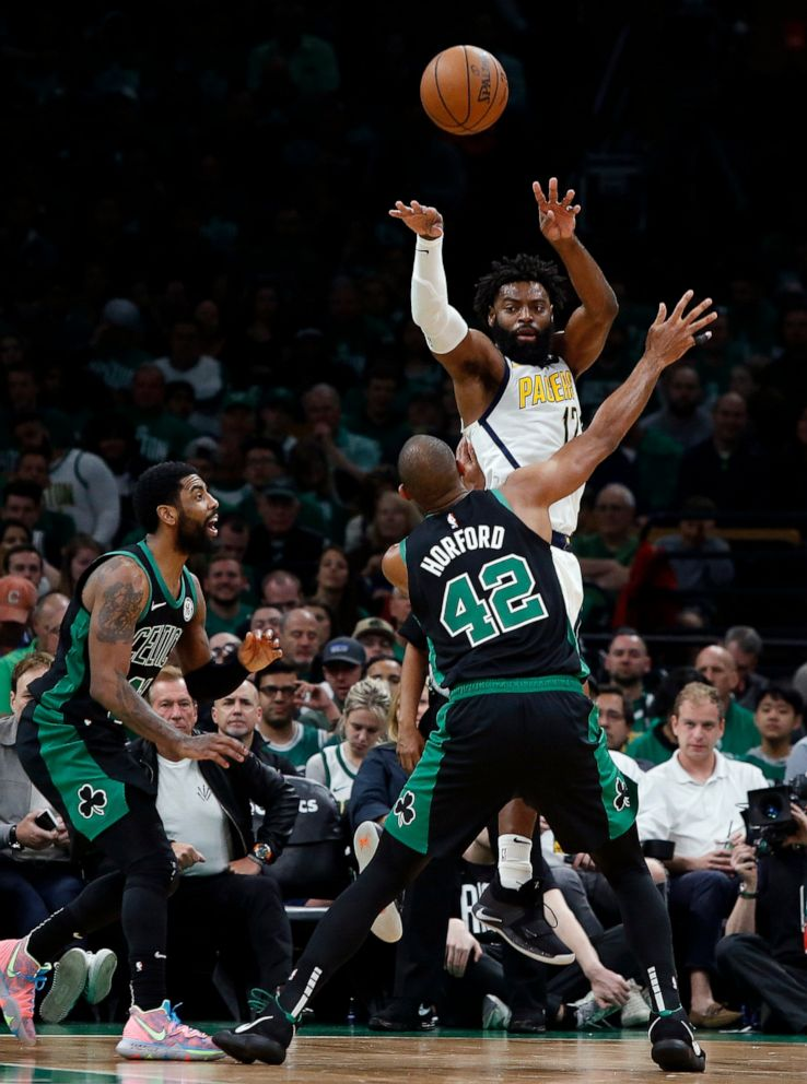 PHOTO: Indiana Pacers Tyreke Evans throws a pass over Boston Celtics Al Horford during the second quarter in Game 1 of a first-round NBA basketball playoff series, Sunday, April 14, 2019, in Boston.
