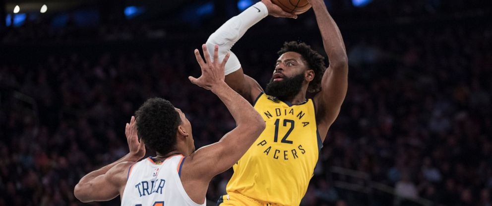 PHOTO: Indiana Pacers guard Tyreke Evans (12) shoots over New York Knicks guard Allonzo Trier (14) during the first half of an NBA basketball game Friday, Jan. 11, 2019, at Madison Square Garden in New York.