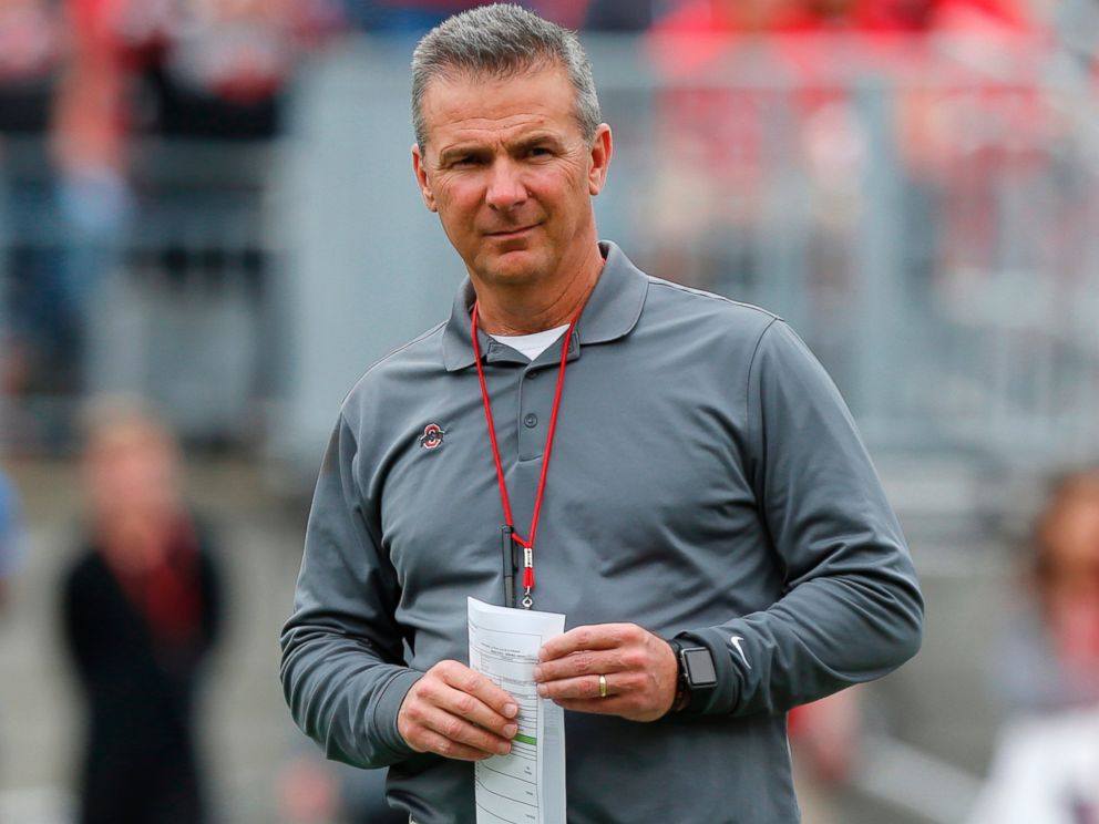 In this April 14, 2018, file photo, Ohio State coach Urban Meyer watches the NCAA college football teams spring game in Columbus. The university has placed Meyer on paid administrative leave.