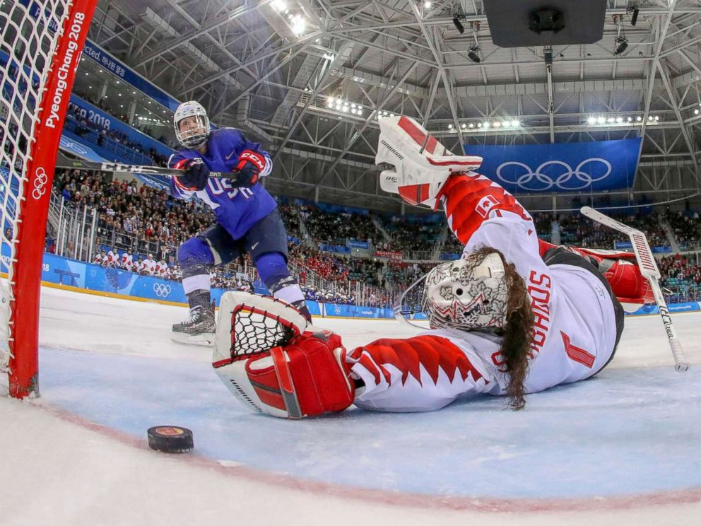 PHOTO: American Jocelyne Lamoureux-Davidson scores a game winning goal against goalie Shannon Szabados of Canada, in the penalty shootout during the womens gold medal hockey game, Feb. 22, 2018.