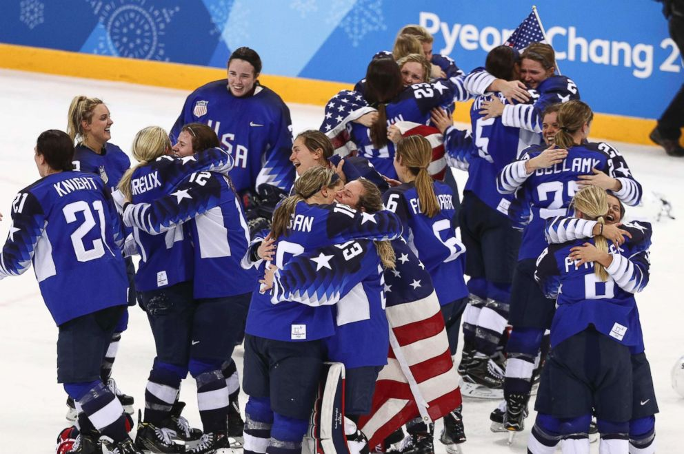 PHOTO: Members of the The United States womens hockey team celebrate after defeating Canada 3-2 in a shootout to win the gold medal game, Feb. 22, 2018.