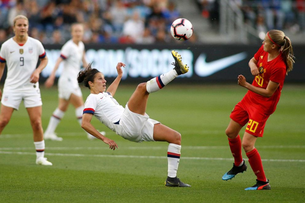 PHOTO: Carli Lloyd #10 of United States Womens National Team kicks the ball away from Julie Biesmans #20 of Belgian Womens National Team during the first half of a game at Banc of California Stadium, April 7, 2019, in Los Angeles.