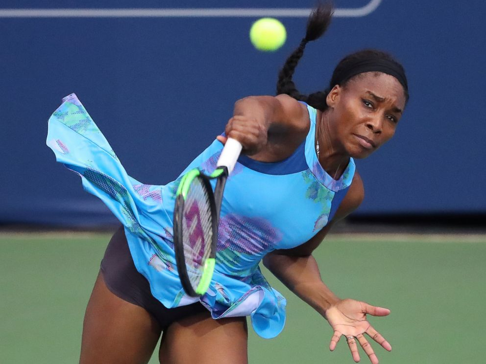 PHOTO: Venus Williams serves to Canadas Genie Bouchard in a special womens exhibition tennis match at the BB&T Atlanta Open Tournament, July 23, 2017, in Atlanta.