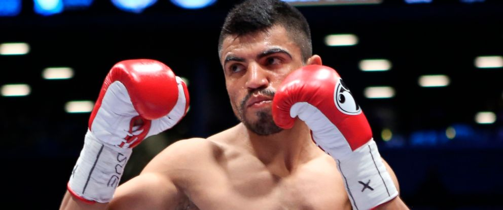 PHOTO: In this Jan. 30, 2014, file photo, Victor Ortiz faces Luis Collazo, not seen, in a welterweight boxing bout in the Brooklyn borough of New York.