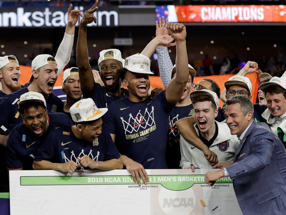 PHOTO: Virginia head coach Tony Bennett celebrates with his team after defeating Texas Tech 85-77 in the overtime in the championship of the Final Four NCAA college basketball tournament, Monday, April 8, 2019, in Minneapolis.