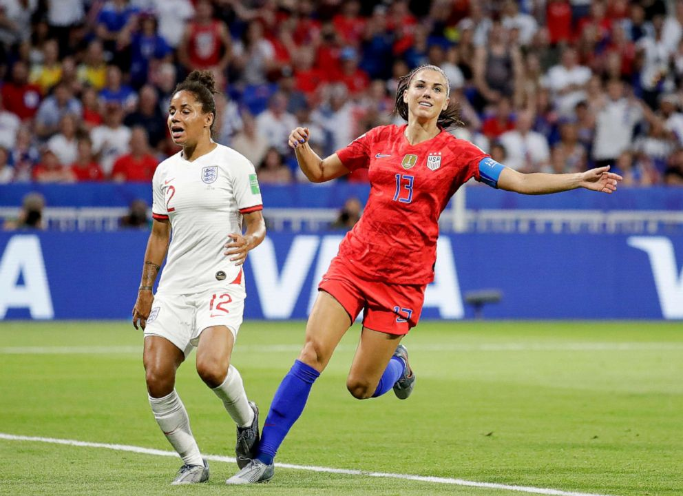 PHOTO: US Alex Morgan, right, celebrates after scoring her second goal next to Englands Demi Stokes during the Womens World Cup semifinal soccer match between England and the United States at the Stade de Lyon in Lyon, France, July 2, 2019.