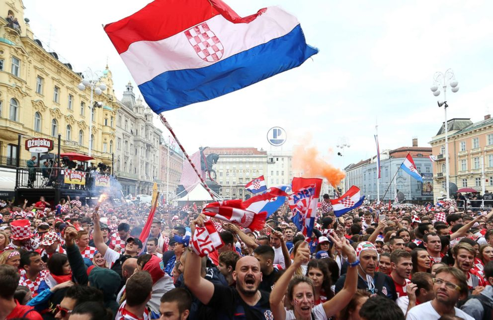 PHOTO: Croatias fans are seen before the broadcast of the World Cup final match at the citys main square, July 15, 2018 in Zagreb, Croatia.