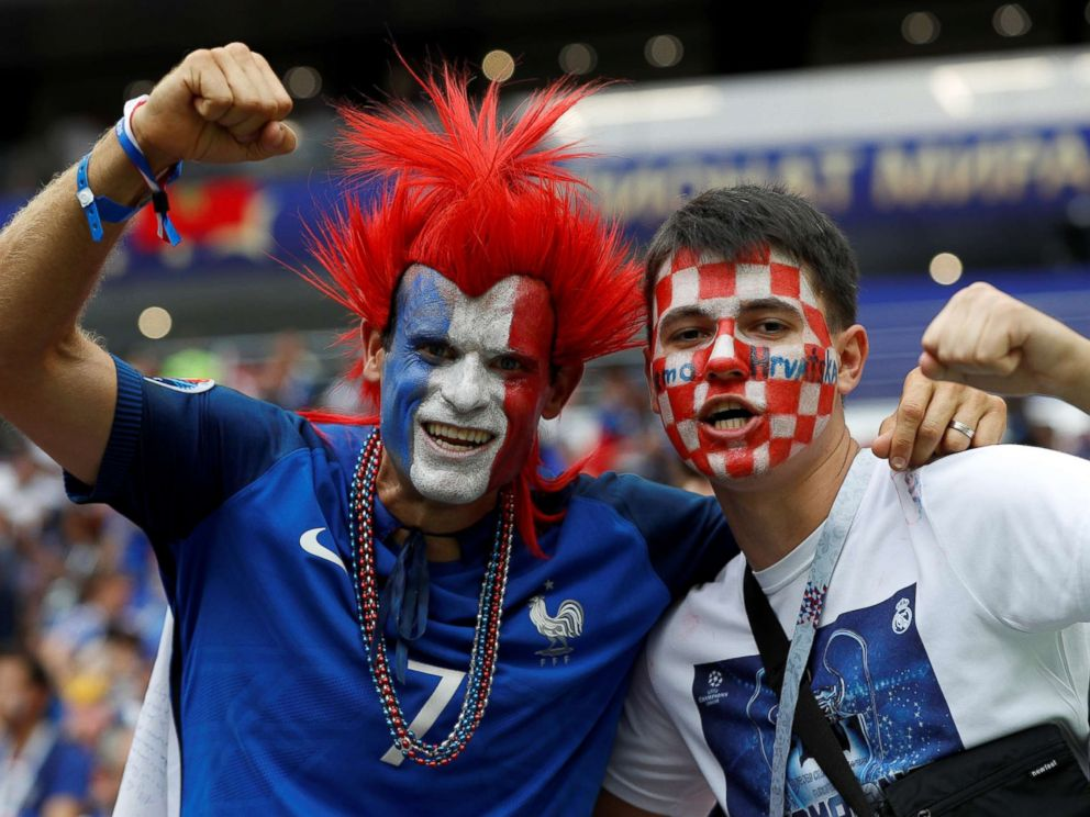 PHOTO: A France fan and a Croatia fan pose for a photo inside Luzhniki Stadium before the World Cup match in Moscow, July 15, 2018.