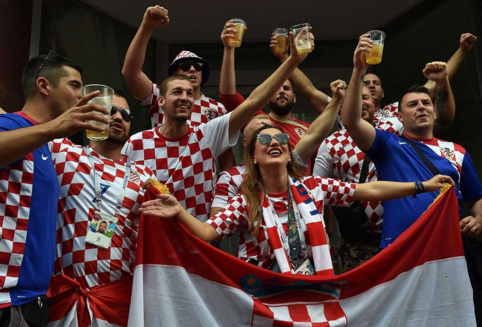 PHOTO: Croatias supporters cheer at the Nikolskaya street in central Moscow on July 15, 2018 before the final match between Croatia and France during the Russia 2018 World Cup football tournament.