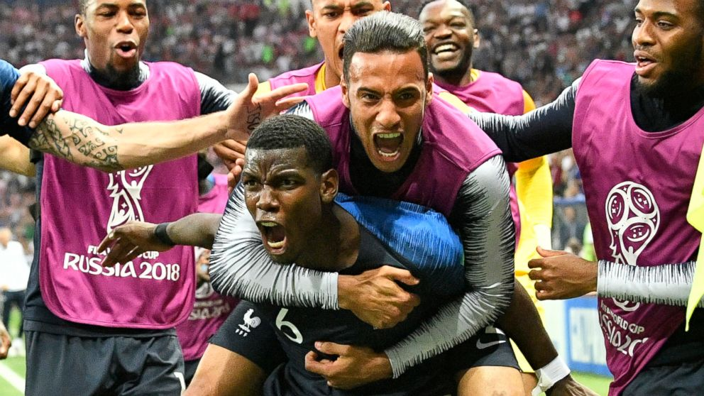 France's Paul Pogba celebrates after scoring his side's third goal during the final match between France and Croatia at the 2018 soccer World Cup in the Luzhniki Stadium in Moscow, Russia, July 15, 2018.