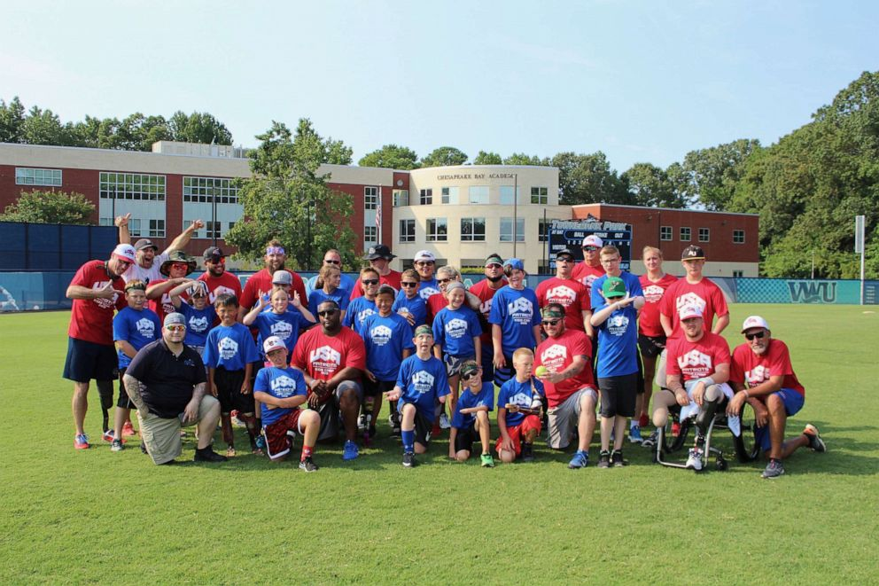 PHOTO: A team photo at the kids camp by Wounded Warrior Amputee Softball Team. This years camp was hosted by Virginia Wesleyan University in Virginia Beach.