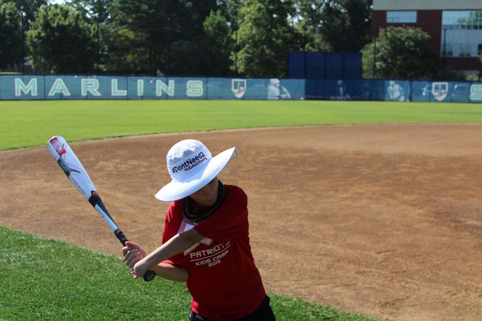 PHOTO: Nolan Edwards takes a swing at the kids camp by Wounded Warrior Amputee Softball Team. The team changed its name to USA Patriots and plays across the U.S.