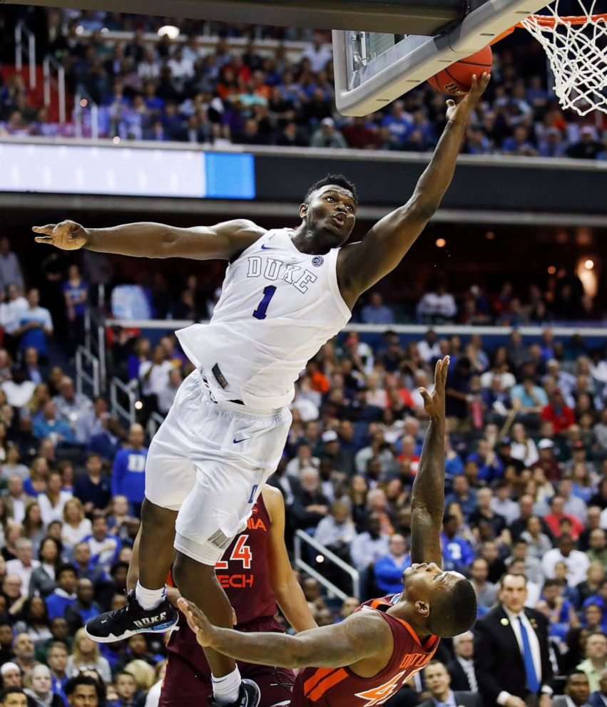 PHOTO: Duke forward Zion Williamson drives to the basket to score on Virginia Techs guard Ty Outlaw during an NCAA mens college basketball tournament East Region semifinal in Washington, March 29, 2019.