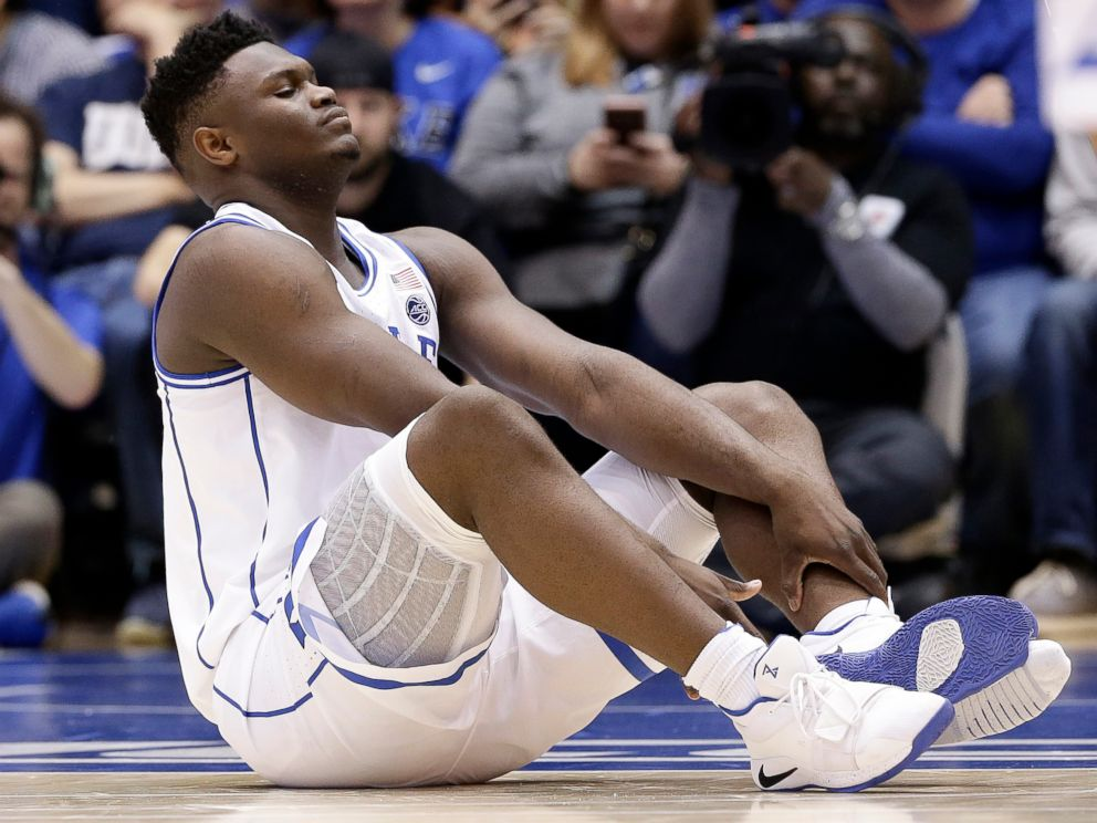 PHOTO: Dukes Zion Williamson sits on the floor following a injury during the first half of an NCAA college basketball game against North Carolina in Durham, N.C., Wednesday, Feb. 20, 2019.