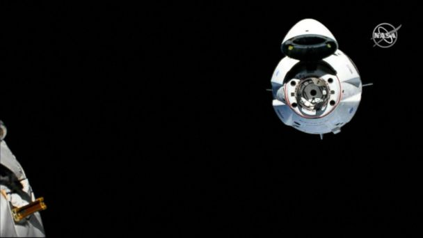 SpaceX capsule becomes 1st commercial spacecraft to dock with International Space Station