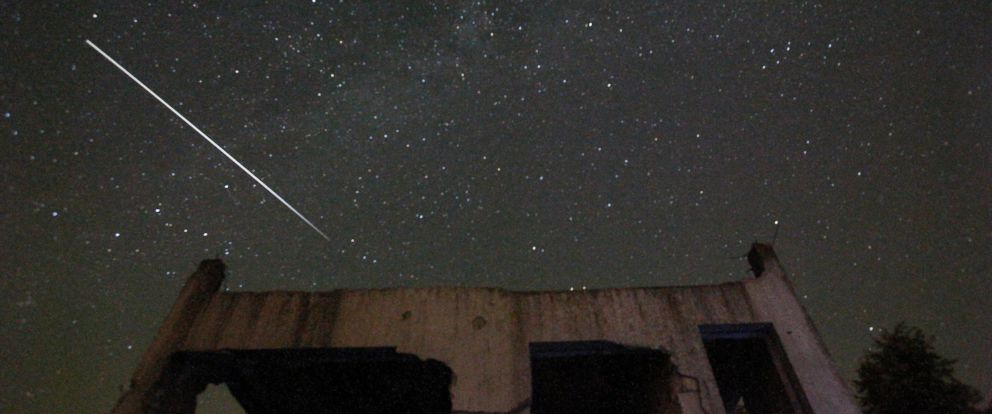 PHOTO: Stars and meteor streaks are seen behind a destroyed house, near Tuzla, Bosnia, Aug. 12, 2015.