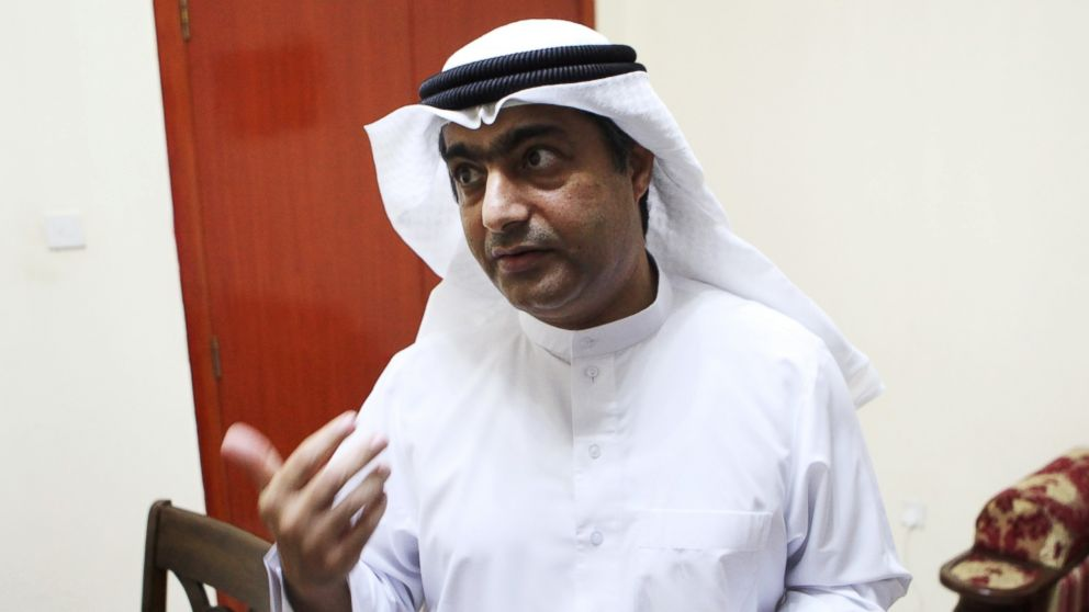 Human rights activist Ahmed Mansoor speaks to Associated Press journalists in Ajman, United Arab Emirates, Aug. 25, 2016.