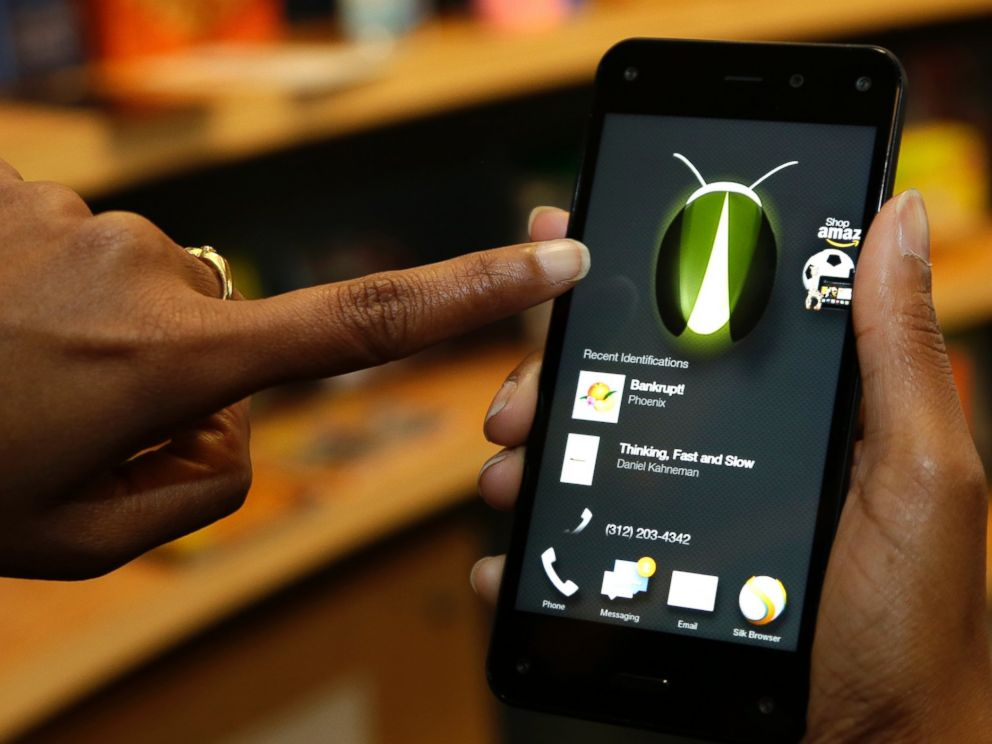 PHOTO: The new Amazon Fire Phones Firefly feature, which lets the user take a photo of objects, numbers, artwork or books and have the phone recognize the item, is demonstrated in Seattle on June 18, 2014.