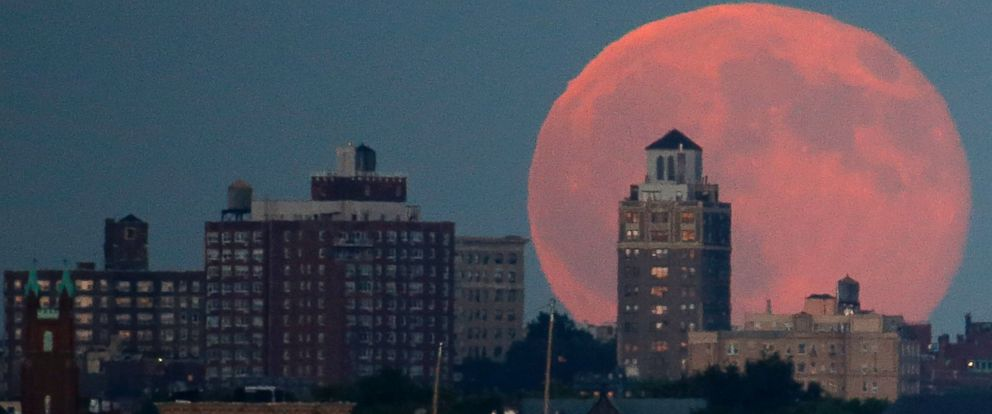 PHOTO: A blue moon rises behind Brooklyn seen from Liberty State Park in Jersey City, N.J., July 31, 2015.