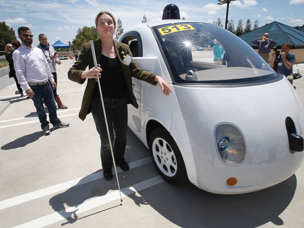 PHOTO: Jessie Lorenz, of San Francisco, touches the new Google self-driving prototype car during a demonstration at the Google campus in Mountain View, Calif.
