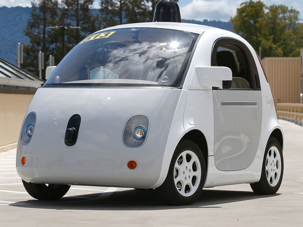 Photo Googles New Self Driving Prototype Car Drives Around A Parking Lot During