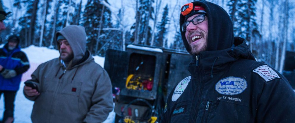 PHOTO: Musher Brent Sass, right, relaxes after arriving in Fairbanks for the start of the Iditarod