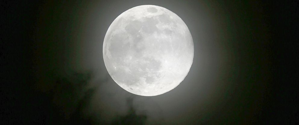 "PHOTO: The moon rises Saturday, July 12, 2014 over metropolitan Manila in the Philippines in one of the three ""Supermoon"" occurrences for this year."