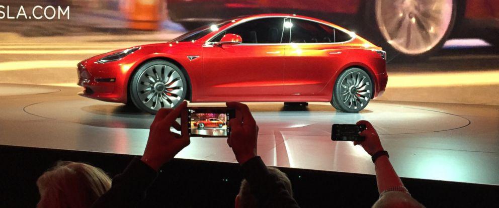 PHOTO: Tesla Motors unveils the new lower-priced Model 3 sedan at the Tesla Motors design studio in Hawthorne, California, March 31, 2016.